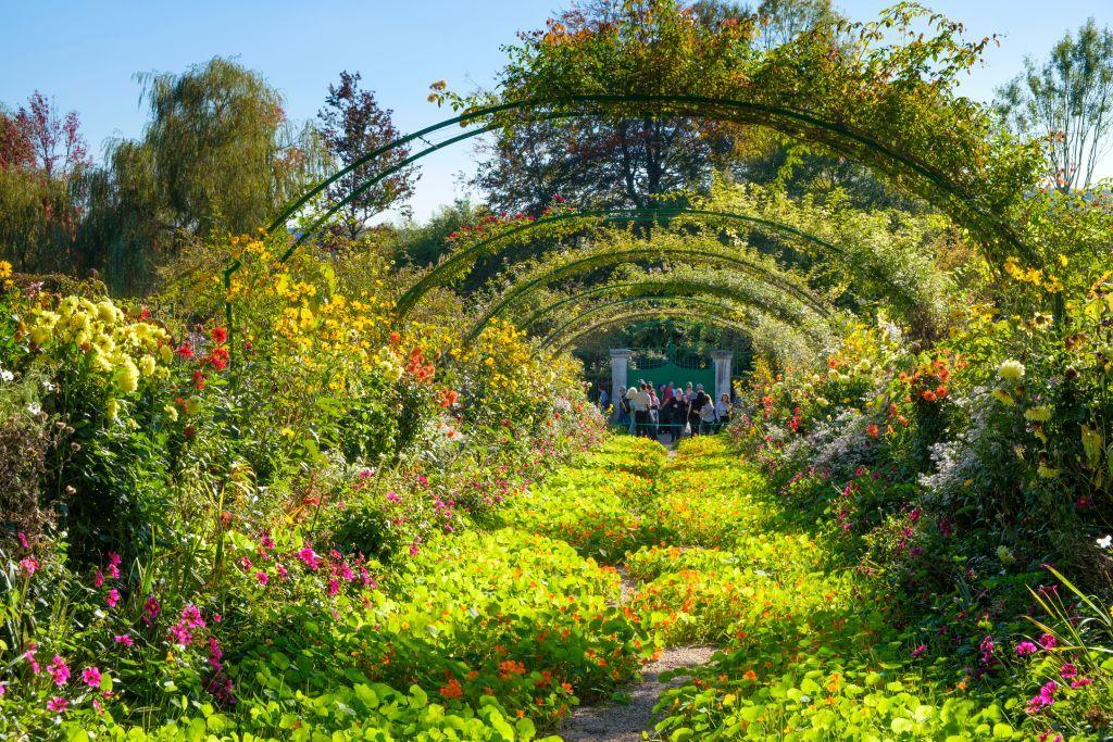 """<p>Legend has it that famed French painter Claude Monet decided he had to move to Giverny, France, upon seeing the quaint village from a train window. After purchasing his own house and land in Giverny, Monet manifested his vision of creating his own picturesque gardens so that he could paint them. <em>Water Lilies,</em> a series of some 250 paintings by Monet, was all inspired by his gardens, which includes prominent works like The Water Lily Pond, known for its Japanese bridge overlooking a tranquil pond of lilies. Monet's garden was his main source of artistic inspiration for the last three decades of his life, and he even painted numerous creations while dealing with visual impairment of cataracts. When you're done touring the gardens, you can also <a href=""""http://fondation-monet.com/visite-virtuelle/"""" target=""""_blank"""">virtually tour </a>Monet's house. </p><p><a class=""""body-btn-link"""" href=""""https://www.youtube.com/watch?v=rjWx2WNXFF4"""" target=""""_blank"""">TOUR NOW </a></p>"""