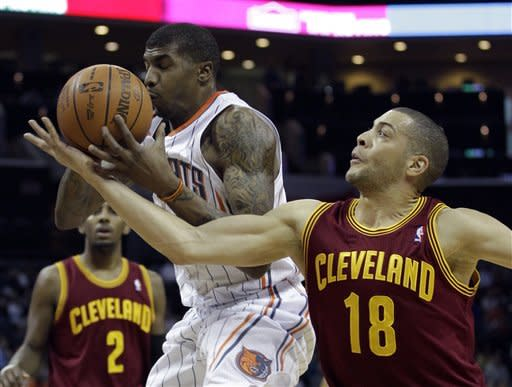 Cleveland Cavaliers' Anthony Parker (18) knocks the ball away from Charlotte Bobcats' Tyrus Thomas (12) during the first half of an NBA basketball game in Charlotte, N.C., Monday, Jan. 16, 2012. (AP Photo/Chuck Burton)