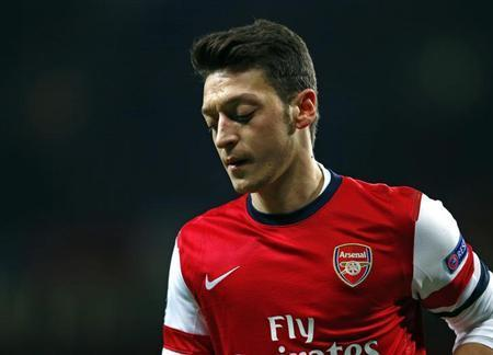 Arsenal's Mesut Ozil reacts after missing a penalty against Bayern Munich during their Champions League round of 16 first leg soccer match at the Emirates Stadium in London February 19, 2014. REUTERS/Eddie Keogh
