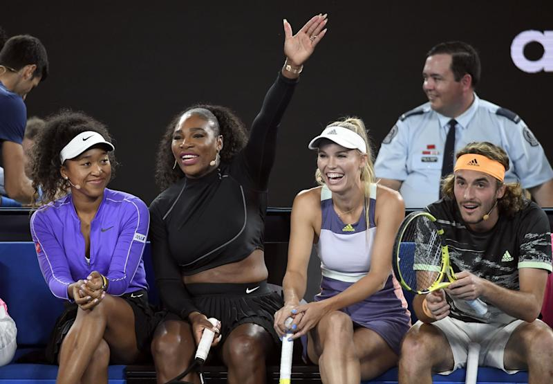 Serena Williams of the US (2/L) shares a lighter moment with Naomi Osaka of Japan (L), Caroline Wozniacki of Denmark (2/R) and Stefanos Tsitsipas of Greece (R) as they and other top players play in the Rally for Relief charity tennis match in support of the victims of the Australian bushfires, in Melbourne of January 15, 2020, ahead of the Australian Open tennis tournament. (Photo by WILLIAM WEST / AFP) / -- IMAGE RESTRICTED TO EDITORIAL USE - STRICTLY NO COMMERCIAL USE -- (Photo by WILLIAM WEST/AFP via Getty Images)
