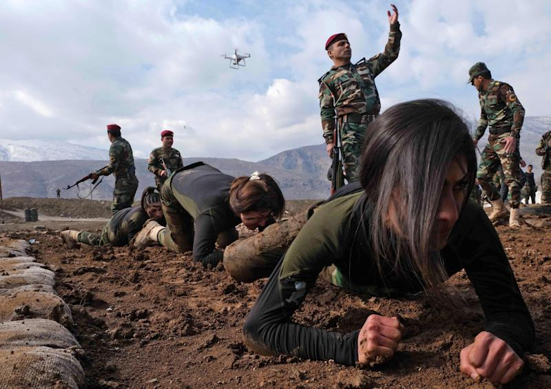 Women and men train and fight together (AFP via Getty Images)