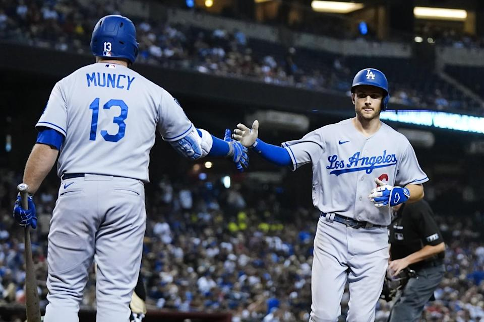 The Dodgers' Trea Turner celebrates his sixth-inning home run with Max Muncy on Sept. 25, 2021.