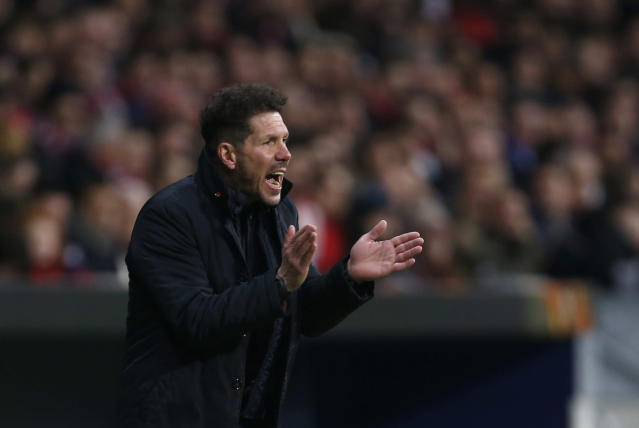 FILE - In this Thursday, Feb. 22, 2018 file photo, Atletico Madrid head coach Diego Simeone reacts during an Europa League round of 32 second leg soccer match between Atletico Madrid and Copenhagen at the Metropolitano stadium in Madrid. Nearly 20 years after his father scuppered Juventus' title hopes, Giovanni Simeone has made it up to the Serie A club. Current Atletico Madrid coach Diego Simeone fired Lazio to a 1-0 win against Juventus in April 2000, with the capital club going on to finish a point above the Bianconeri to win the title. On Sunday, 18 years later, the younger Simeone netted a hat trick to help Fiorentina beat Juve's closest challengers Napoli 3-0 and leave the Bianconeri on the brink of a seventh successive title. (AP Photo/Francisco Seco, File )