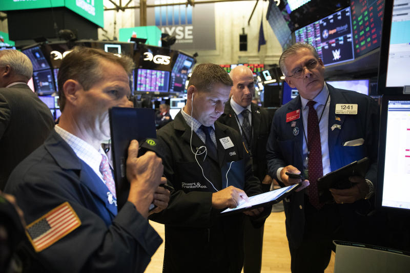 Stock traders work at the New York Stock Exchange, Wednesday, Sept. 18, 2019. The Federal Reserve is expected to announce its benchmark interest rate later in the day. (AP Photo/Mark Lennihan)
