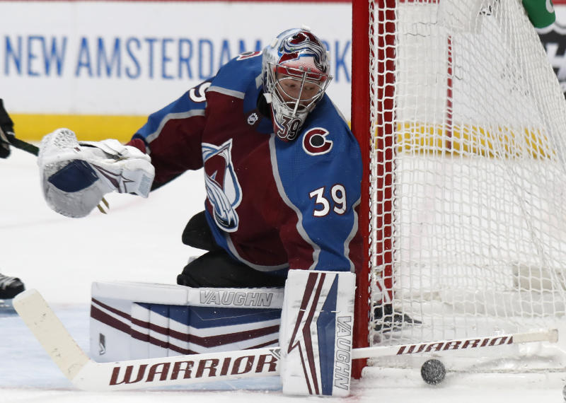 Colorado Avalanche goaltender Pavel Francouz turns away a shot from the New York Islanders during the second period of an NHL hockey game Wednesday, Feb. 19, 2020, in Denver. (AP Photo/David Zalubowski)