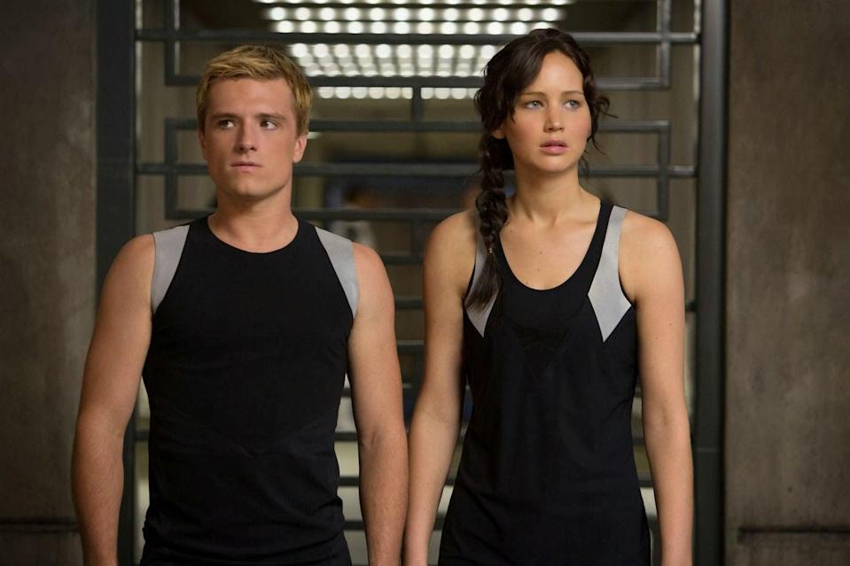 <p><strong>For Katniss:</strong> Going for the Games look? Sport the signature side braid, green cargo pants, boots, an anorak, and a backpack filled with arrows.</p> <p><strong>For Peeta:</strong> A t-shirt, work pants, boots, and maybe a bit of ruddy face paint on the cheeks, and you're good to go.</p>