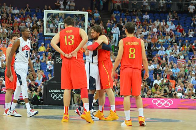 LONDON, ENGLAND - AUGUST 12: Kobe Byrant #10 of the US Men's Senior Nation Team hugs Pau Gasol #4 of Spain during their Men's Gold Medal Basketball Game on Day 16 of the London 2012 Olympic Games at the North Greenwich Arena on August 12, 2012 in London, England. NOTE TO USER: User expressly acknowledges and agrees that, by downloading and/or using this Photograph, user is consenting to the terms and conditions of the Getty Images License Agreement. Mandatory Copyright Notice: Copyright 2012 NBAE (Photo by Jesse D. Garrabrant/NBAE via Getty Images)