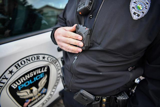 <p>In this Feb. 16, 2017 photo, Burnsville Police Sgt. Chris Wicklund turns his his body camera off after completing a call in Burnsville, Minn. When a Minneapolis police officer shot and killed Justine Damond, who had called in a possible crime in the alley behind her house on July 15, his body camera wasn't running. Criminal-justice experts say the early numbers suggest that officers aren't turning them on often enough, and Minneapolis isn't the only city where that's the case. (Photo: Glen Stubbe/Star Tribune via AP) </p>