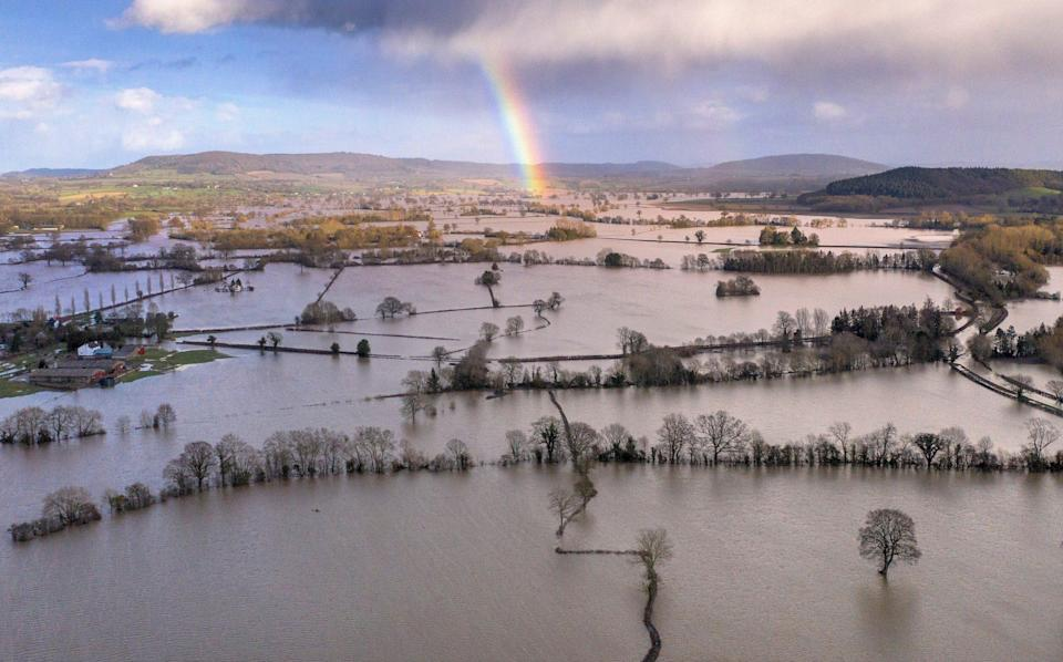A rainbow appears over flooded fields in the Wye Valley, near the hamlet of Wellesley, following Storm Dennis on February 17, 2020 in Hereford - Christopher Furlong/Getty Images