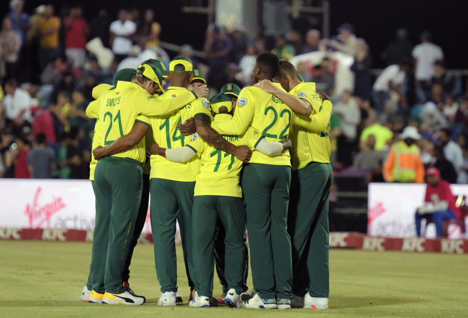 A team talk by South Africa during the T20 cricket match between South Africa and England in East London, South Africa, Wednesday, Feb. 12, 2020. (AP Photo/Michael Sheehan)