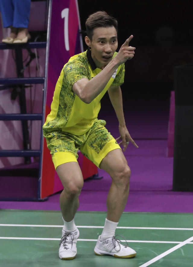 Malaysia's Lee Chong Wei celebrates after defeating India's Srikanth Kidambi during their men's singles badminton final match at Carrara Sports Hall during the Commonwealth Games on the Gold Coast, Australia, Sunday, April 15, 2018. (AP Photo/Dita Alangkara)