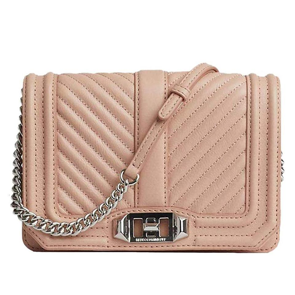 "<p><strong>Rebecca Minkoff</strong></p><p>amazon.com</p><p><strong>$169.75</strong></p><p><a href=""https://www.amazon.com/dp/B084MGGZ5P?tag=syn-yahoo-20&ascsubtag=%5Bartid%7C10049.g.34329922%5Bsrc%7Cyahoo-us"" rel=""nofollow noopener"" target=""_blank"" data-ylk=""slk:Shop Now"" class=""link rapid-noclick-resp"">Shop Now</a></p><p>With quilted detailing and a charming chain strap, this classic crossbody will never go out of style. (It's almost like the cool, younger sister of Chanel 2.55 purse.) </p>"