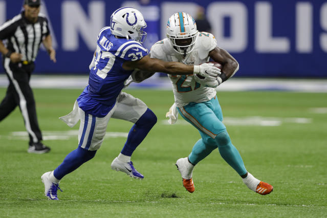 File-This Nov. 10, 2019, file photo shows Indianapolis Colts safety Khari Willis (37) tackling Miami Dolphins running back Kalen Ballage (27) during the second half of an NFL football game in Indianapolis. Ballages historically unproductive season ended Tuesday, Dec. 3, 2019, when he was placed on injured reserve by the Dolphins. Ballage hurt his left leg in Sundays victory over Philadelphia. The second-year pro finishes the season with 135 yards in 74 carries. His 1.8-yard average is the worst by a running back with at least 70 carries since Phil Sarboe had a 1.2-yard average for two teams in 1936. (AP Photo/Darron Cummings, File)