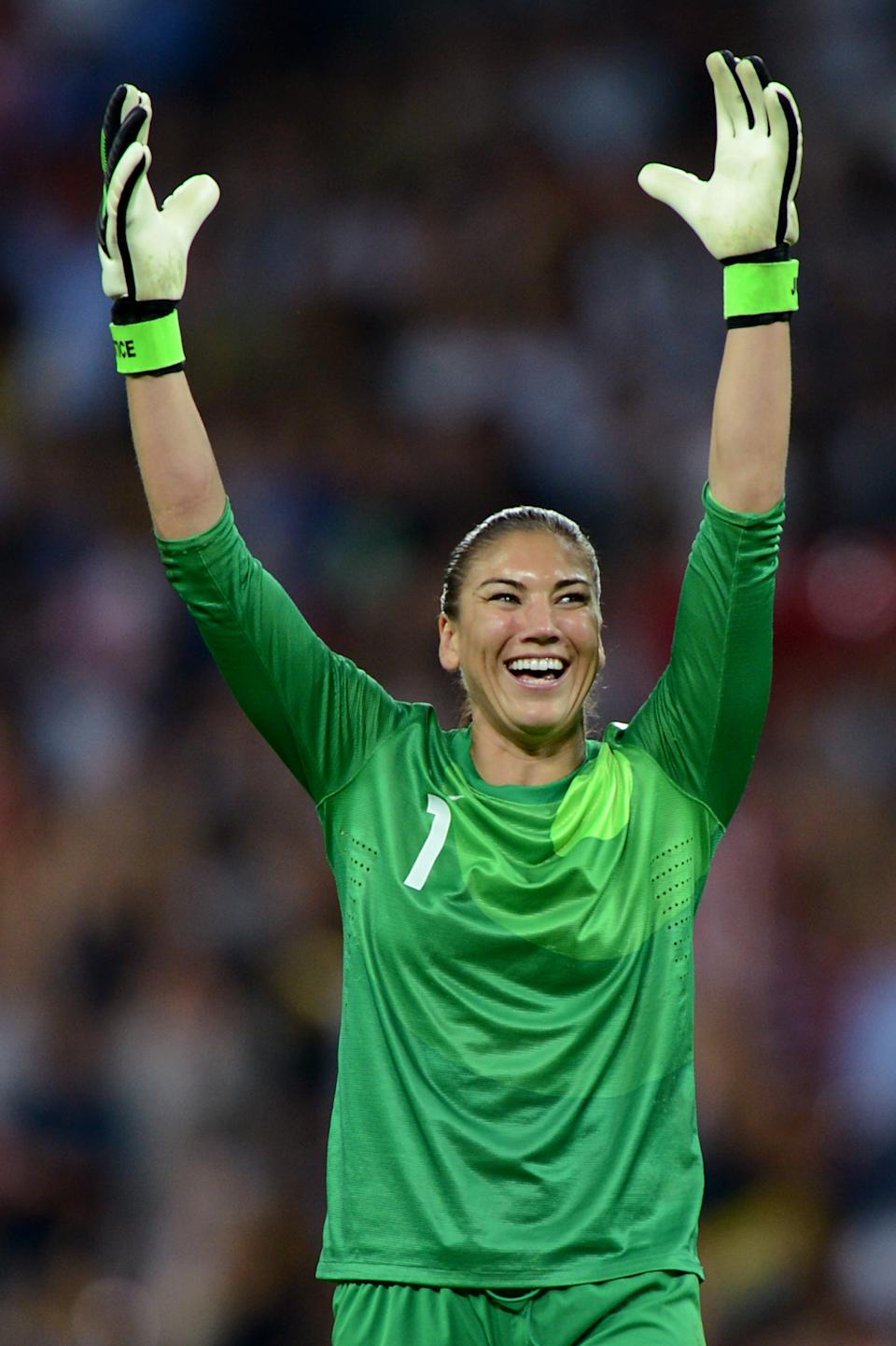 LONDON, ENGLAND - AUGUST 09: Hope Solo #1 of United States reacts after a goal by Carli Lloyd #10 in the second halfagainst Japan during the Women's Football gold medal match on Day 13 of the London 2012 Olympic Games at Wembley Stadium on August 9, 2012 in London, England. (Photo by Michael Regan/Getty Images)