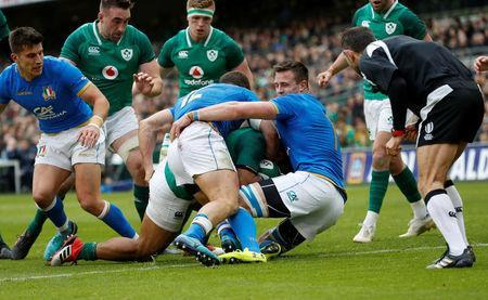 Rugby Union - Six Nations Championship - Ireland vs Italy - Aviva Stadium, Dublin, Republic of Ireland - February 10, 2018 Ireland's Bundee Aki scores their third try as Italy's Tommaso Castello and Braam Steyn attempt to tackle REUTERS/Russell Cheyne