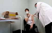 FILE PHOTO: Healthcare worker Kertesz receives Pfizer-BioNTech COVID-19 vaccine in Budapest