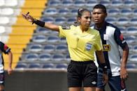 Melany Bermejo, a 37-year-old PE teacher, has served as referee at second-division masculine games in her native Peru (AFP Photo/Cris Bouroncle)