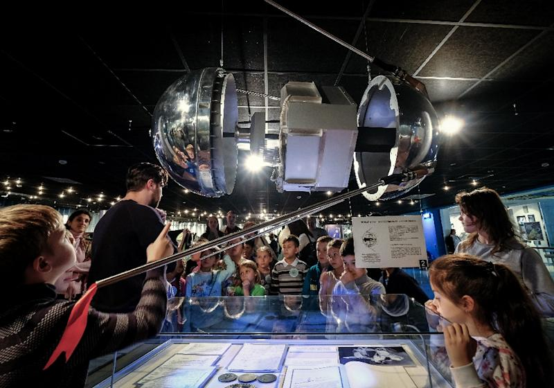 Sixty years ago, the Soviet Union launched the first artificial satellite known as Sputnik, a tiny silver sphere with four spider leg-like antennae (AFP Photo/Yuri KADOBNOV)