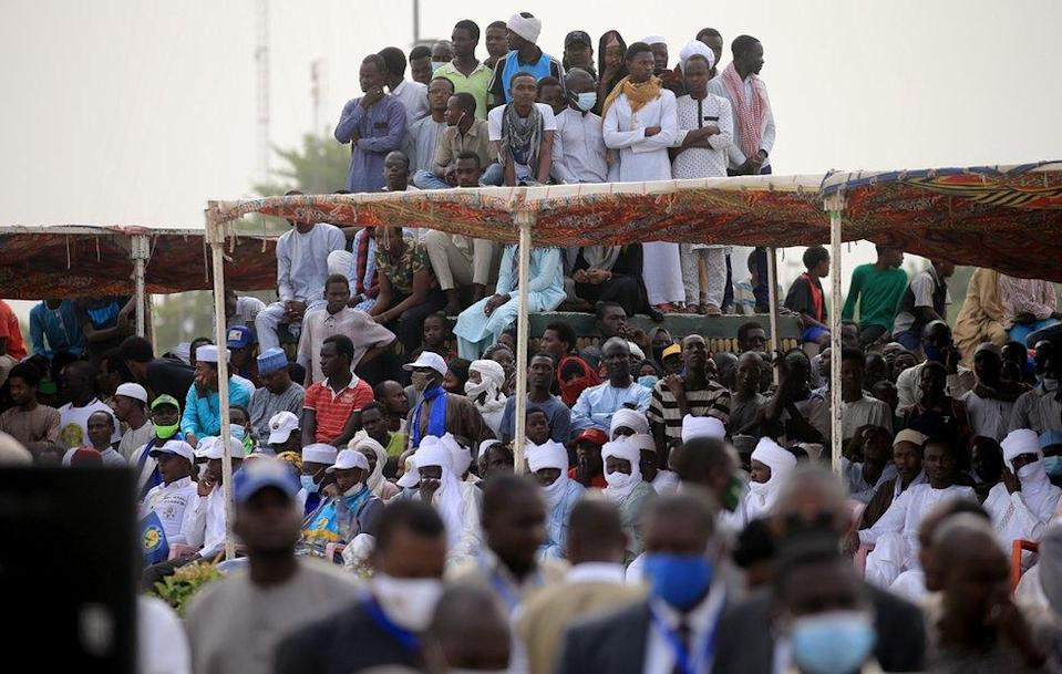 "A crowd gathers to witness the state funeral for the late Chadian president Idriss Deby in N""Djamena, Chad, 23 April 2021. Chad""s President Idriss Deby died of injuries suffered in clashes with rebels in the country""s north, an army spokesperson announced on state television on 20 April 2021. Deby had been in power since 1990 and was re-elected for a sixth term in the 11 April 2021 elections. The state funeral will take place on the morning of 23 April 2021, attended by French President Emmanuel Macron."