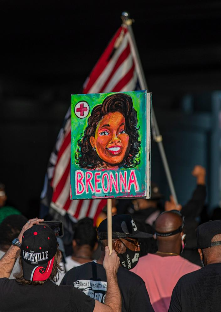 A portrait of Breonna Taylor is carried by protesters as they march through downtown Louisville at sunset on Friday evening. Sept. 25, 2020