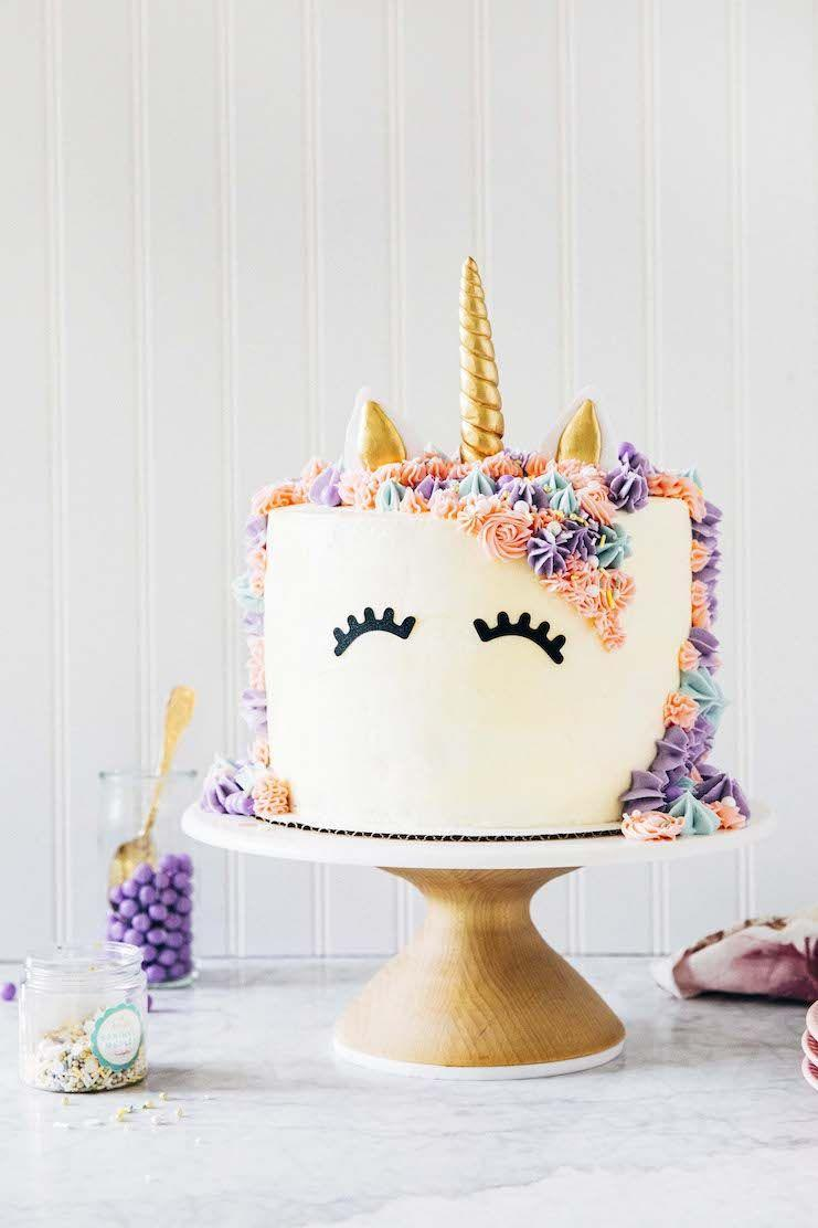 """<p>Bring a little magic to your kid's next birthday with this enchanted treat by Portland, OR-based baker Michelle Lopez. Layer Funfetti cake mix with homemade vanilla buttercream frosting, then decorating with multicolored frosting and top with a shiny gold horn.</p><p><a href=""""https://www.hummingbirdhigh.com/2020/06/rainbow-unicorn-cake.html"""" rel=""""nofollow noopener"""" target=""""_blank"""" data-ylk=""""slk:Get the recipe at Hummingbird High."""" class=""""link rapid-noclick-resp""""><strong><em>Get the recipe at Hummingbird High.</em></strong></a></p>"""