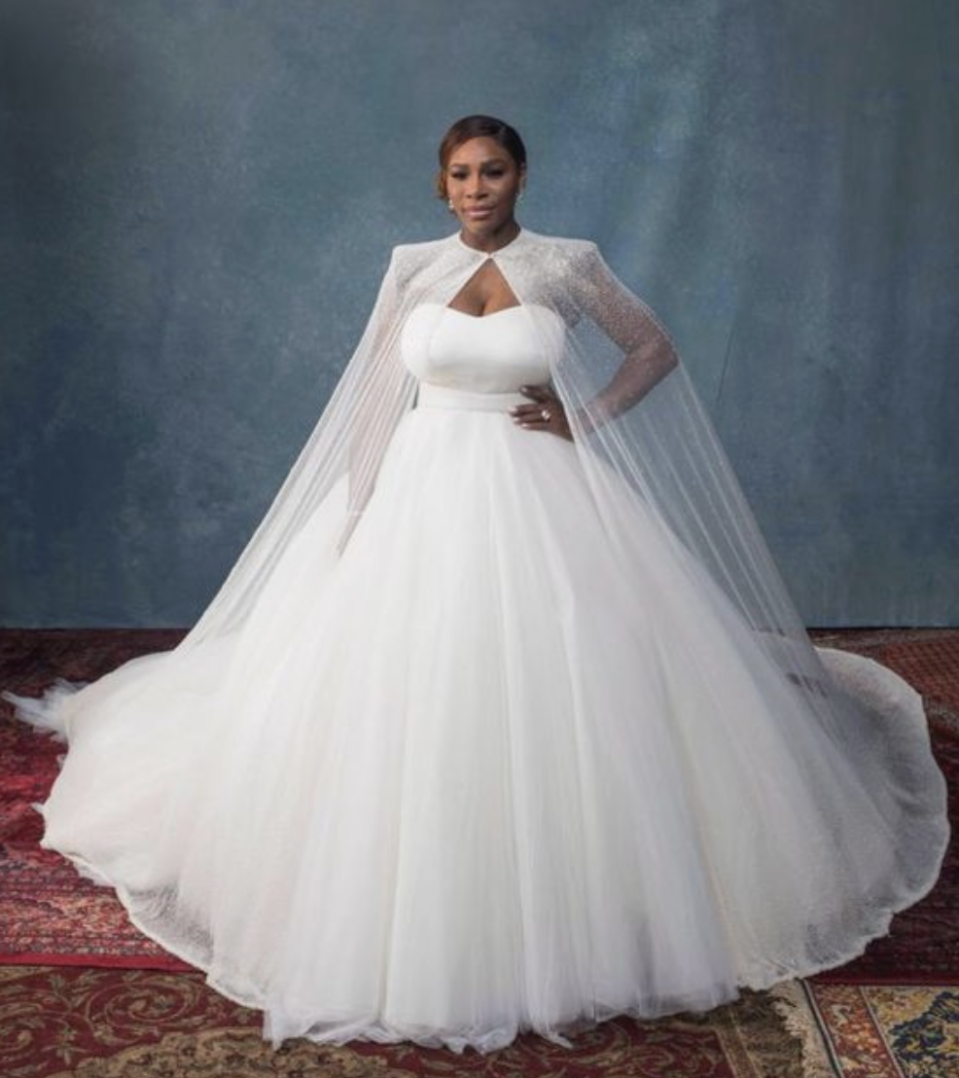 <p>The tennis great walked down the aisle wearing a strapless Sarah Burton for Alexander McQueen princess ball gown and veil.</p>
