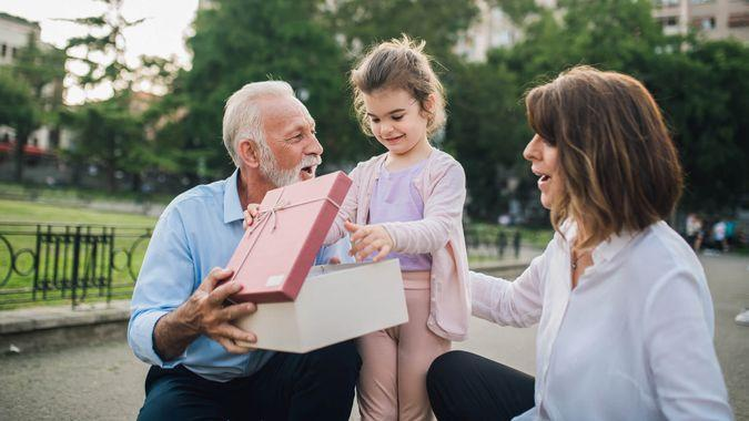 Senior couple with a present for their granddaughter.