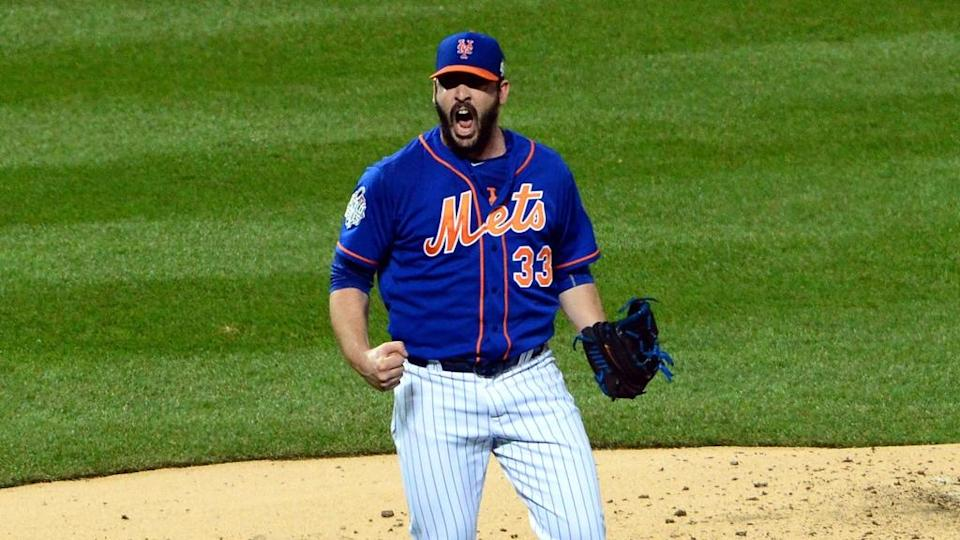 Nov 1, 2015; New York City, NY, USA; New York Mets starting pitcher Matt Harvey reacts after striking out the side in the fourth inning in game five of the World Series against the Kansas City Royals at Citi Field.