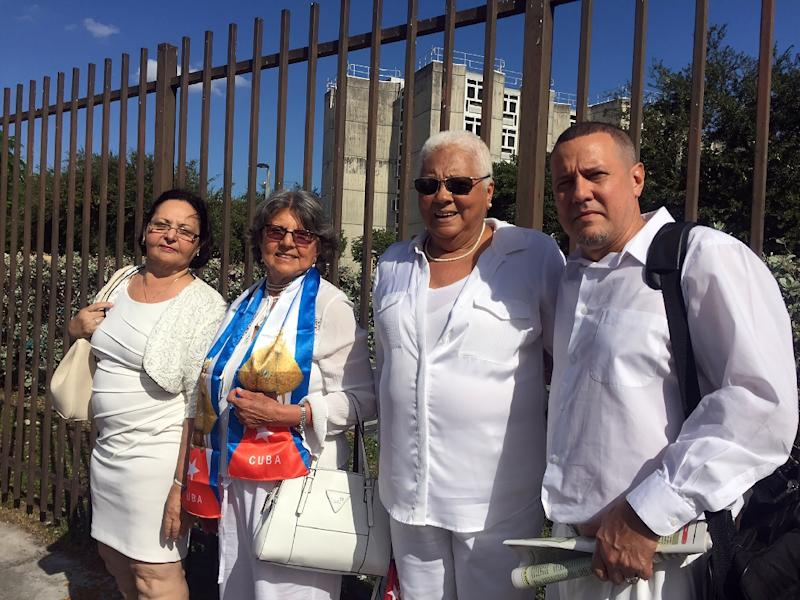 Members of the Ladies in White, a well-known Cuban opposition group formed by wives and relatives of jailed dissidents stand with former political prisoner Heberto Escobedo Morales in Miami on November 27, 2016 (AFP Photo/Leila Macor)