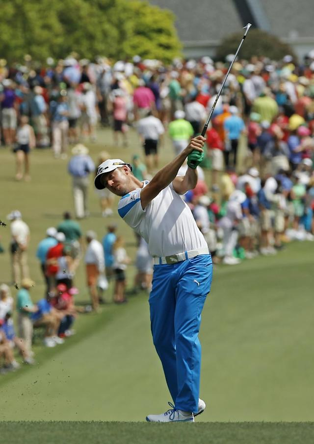 Jonas Blixt, of Sweden, hits his second shot on the first fairway during the fourth round of the Masters golf tournament Sunday, April 13, 2014, in Augusta, Ga. (AP Photo/David J. Phillip)