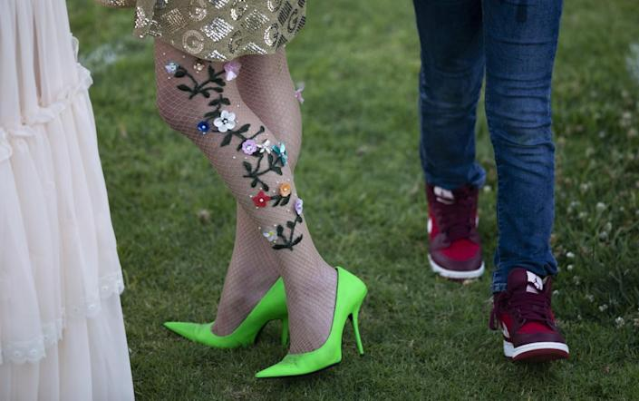 Decorated fishnets and lime heels fit right in alongside jeans and sneakers at the Rose Bowl.
