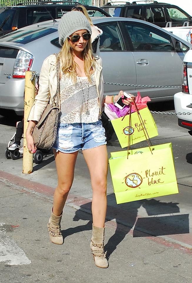 """Who wears short shorts? Ashley Tisdale did during a shop-a-thon at the Planet Blue boutique in L.A. on Wednesday. The """"High School Musical"""" star walked out of the bohemian-inspired clothing store with two bags full of purchases. (2/1/2012)"""