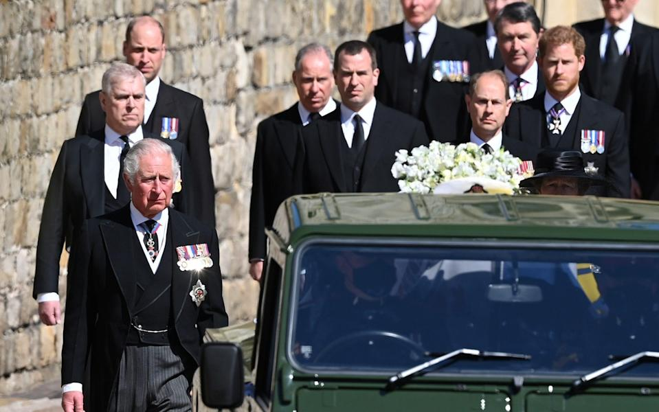 Members of the Royal family wear medals as the follow the Duke of Edinburgh's hearse at Windsor Castle - Hannah McKay/Reuters