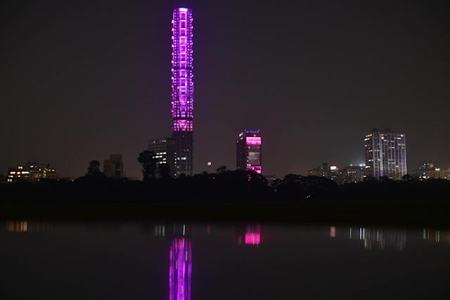 KOLKATA, INDIA NOVEMBER 21: The 42 and Tata Center buildings are illuminated on the eve of India's first pink Ball test match against Bangladesh, as seen from Kolkata Maidan area, on November 21, 2019 in Kolkata, India. (Photo by Samir Jana/Hindustan Times via Getty Images)