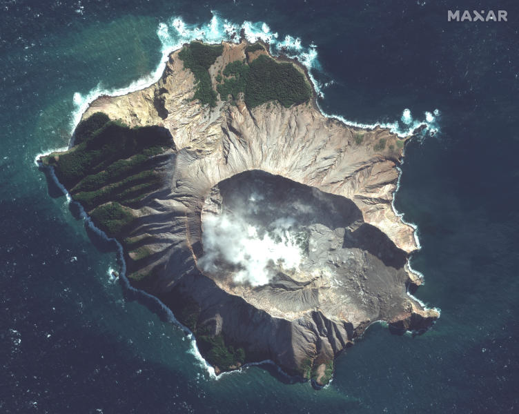 In this satellite image taken and released on May. 12, 2019, by Maxar Technologies steam rises from the volcano on White Island off the coast of Whakatane, New Zealand. A New Zealand island volcano vented more steam and mud Wednesday in an increase of geothermal activity that again delayed the recovery of victims' bodies from a deadly eruption two days ago. (Satellite image ©2019 Maxar Technologies via AP)