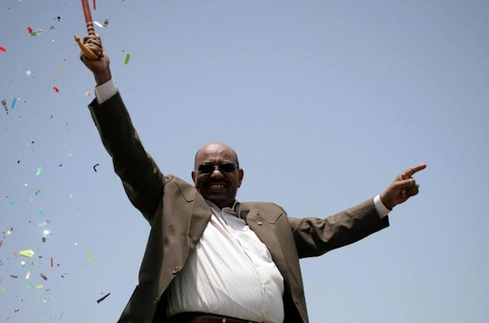 Bashir waves to the crowd at the inauguration of a factory near Al-Dewaim city in White Nile state on July 11, 2012
