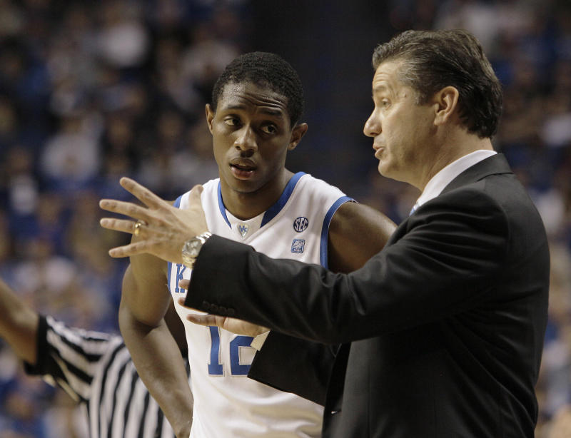 Kentucky guard Brandon Knight listens to coach John Calipari during the second half of Kentucky's 91-57 win in an NCAA college basketball game against Boston University in Lexington, Ky., Tuesday, Nov. 30, 2010. Knight had 23 points. (AP Photo/Ed Reinke)