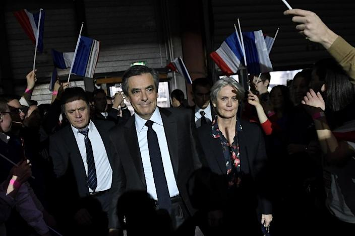 French investigators searched Fillon's (C) office for information on payments totalling around 500,000 euros received by his wife Penelope (R) from public funds (AFP Photo/Eric FEFERBERG)
