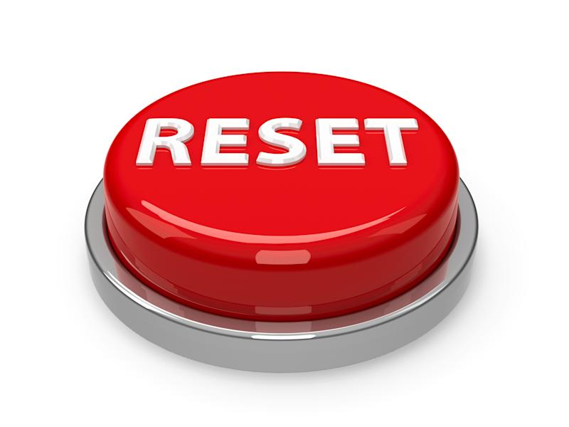 A large red button that reads reset against a white background.