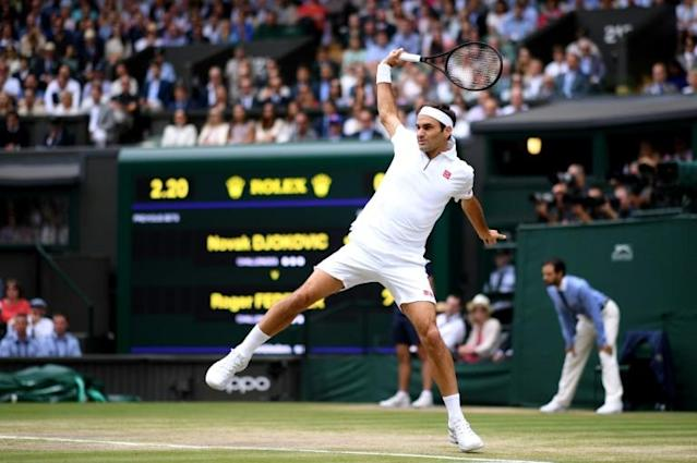 Switzerland's Roger Federer in action at Wimbledon (AFP Photo/Laurence Griffiths)