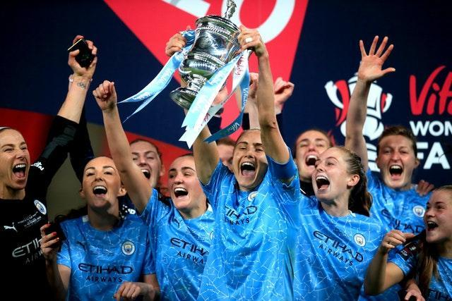 Manchester City captain Steph Houghton lifts the Women's FA Cup for the third time in four seasons. City retained the cup following a 3-1 extra-time victory over Everton in November's behind-closed-doors clash at Wembley. Goals from Georgia Stanway and Janine Beckie earned victory after Everton's Valerie Gauvin cancelled out a first-half header from Sam Mewis to force the additional period