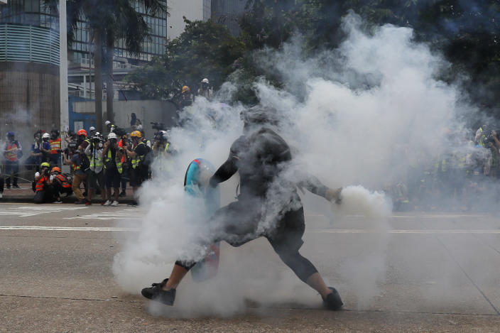 A protester throws a tear gas round back at police during the demonstration in Hong Kong, Sept. 29, 2019. (Photo: Kin Cheung/AP)