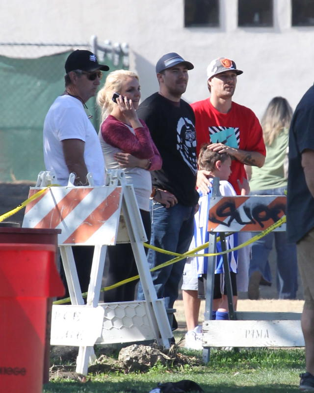 In 2013, things between Britney and Kevin were cordial enough that they could be near each other at their sons' sporting events but were never alone together. Here they are, along with Jamie Spears, left, and Britney's ex-boyfriend David Lucado, second from right. (Photo: Splash News)
