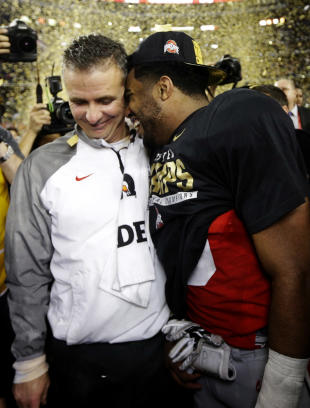 Ohio State head coach Urban Meyer and Ezekiel Elliott celebrate after the NCAA college football playoff championship game against Oregon. (AP Photo/David J. Phillip)