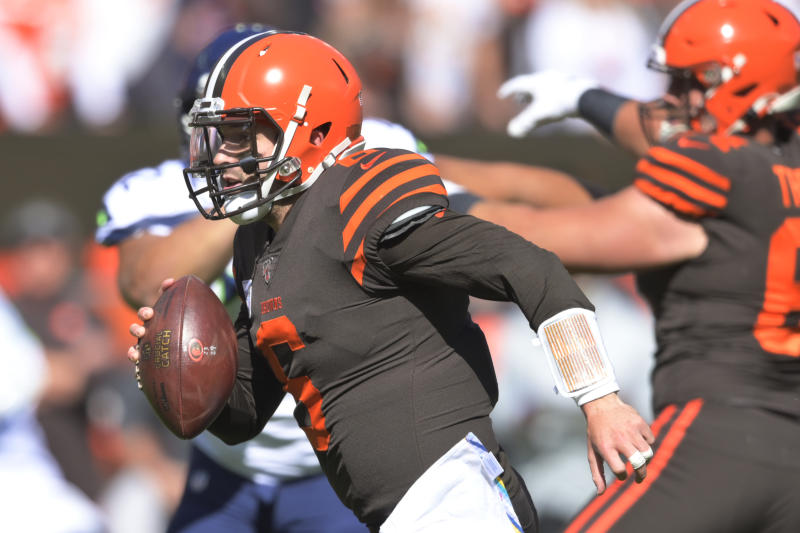 Cleveland Browns quarterback Baker Mayfield rushes for a 10-yard touchdown during the first half of an NFL football game against the Seattle Seahawks, Sunday, Oct. 13, 2019, in Cleveland. (AP Photo/David Richard)