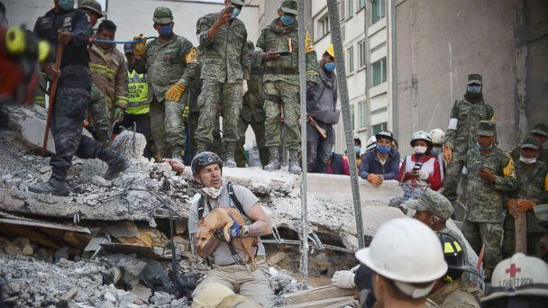 PHOTO: A rescuers pulls a dog out of the rubble during the search for survivors in Mexico City, Sept. 20, 2017, after a strong earthquake hit central Mexico on Sept. 19, 2017. (Yuri Cortez/AFP/Getty Images)
