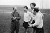 England football team training session at Stamford Bridge ahead of the British Championship international match against Scotland at Wembley. Manager Alf Ramsey talking to his three new caps Barry Bridges, Jackie Charlton and Nobby Stiles. 8th April 1965. (Photo by Charlie Ley/Mirrorpix/Getty Images)