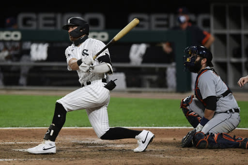 Chicago White Sox's Danny Mendick watches his solo home run during the sixth inning of a baseball game against the Detroit Tigers Monday, Aug. 17, 2020, in Chicago. (AP Photo/Paul Beaty)