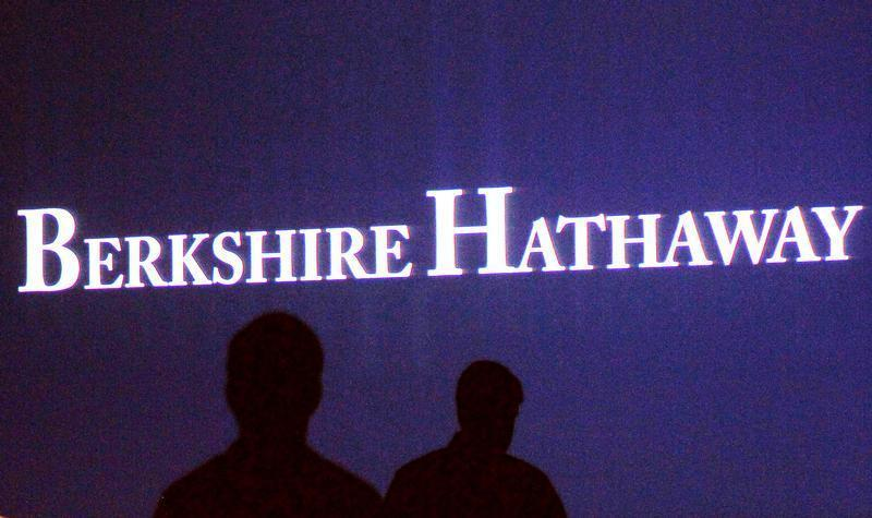 Berkshire Hathaway shareholders walk by a video screen at the company's annual meeting in Omaha