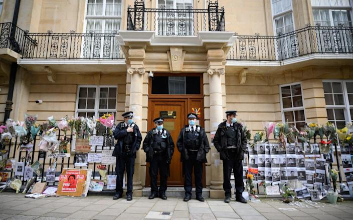 Police officers stand guard after former Myanmar Ambassador to the UK Kyaw Zwar Minn was locked out - Leon Neal/Getty Images Europe